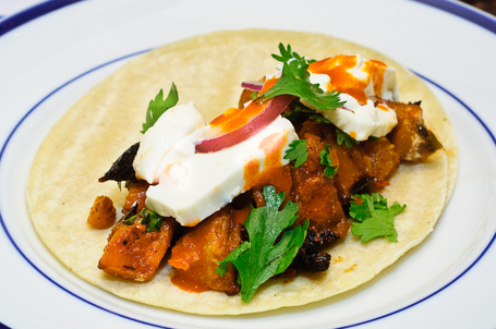 The butternut squash tacos with queso panella, onions, cilantro and hot sauce