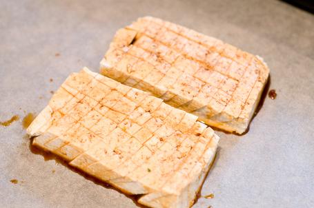 Scored tofu with the sauce